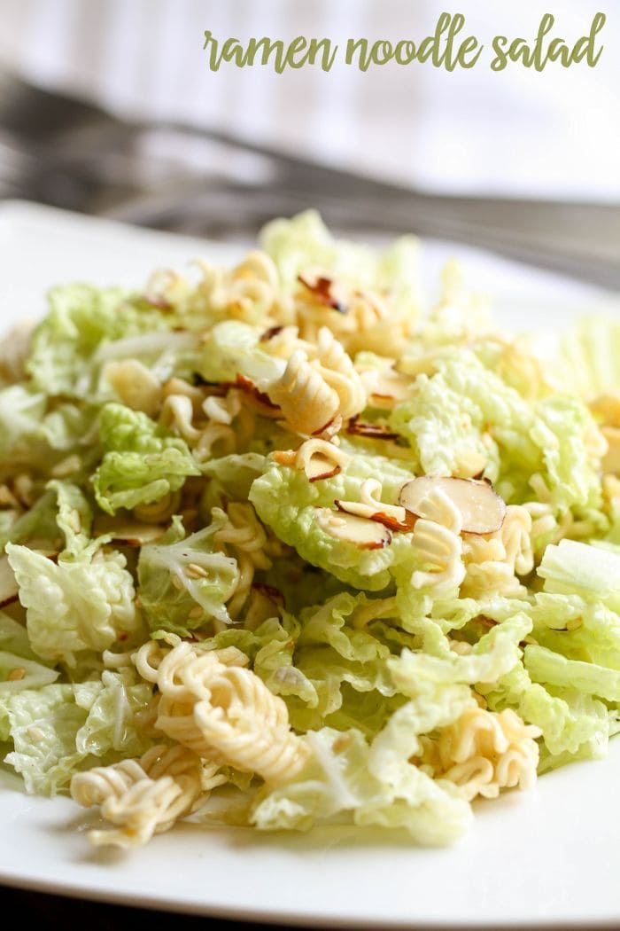 Ramen Noodle Salad - one of our favorites! The perfect side dish! Napa cabbage, slivered almonds, sesame seeds, & ramen mixed with a delicious dressing!