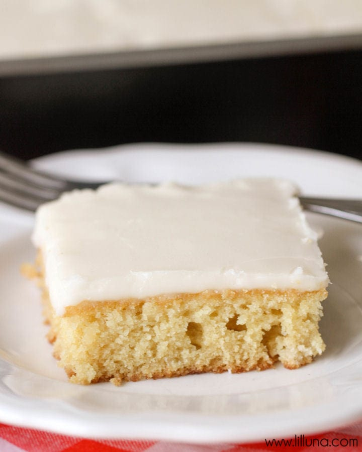 Our favorite cake recipe - White Texas Sheet Cake. It's so moist and has almond extract making it taste AMAZING! { lilluna.com }