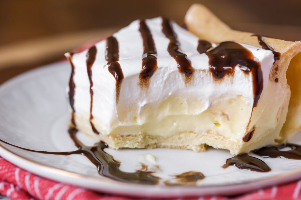 Cream Puff Cake drizzled in chocolate sauce