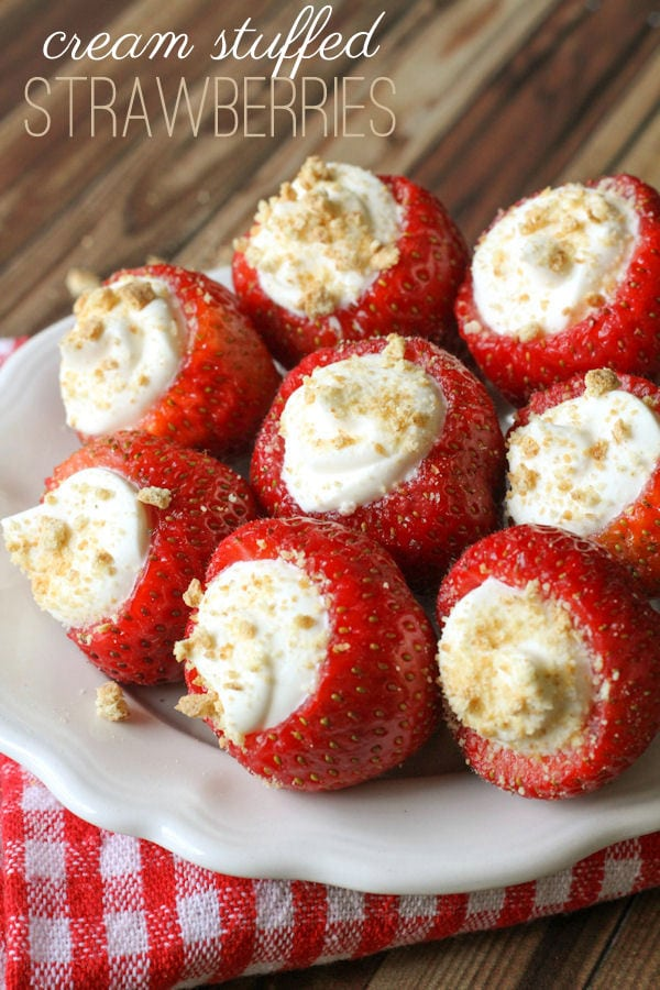 Super delicious Cream Stuffed Strawberries - a quick and yummy treat everyone will love! { lilluna.com } Strawberries stuffed with cream cheese, vanilla, cool whip, butter, and powdered sugar, topped with crushed graham crackers!
