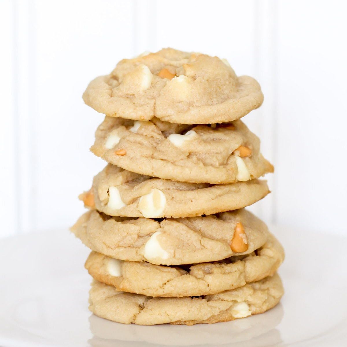 White chocolate butterscotch chip cookies stacked on plate