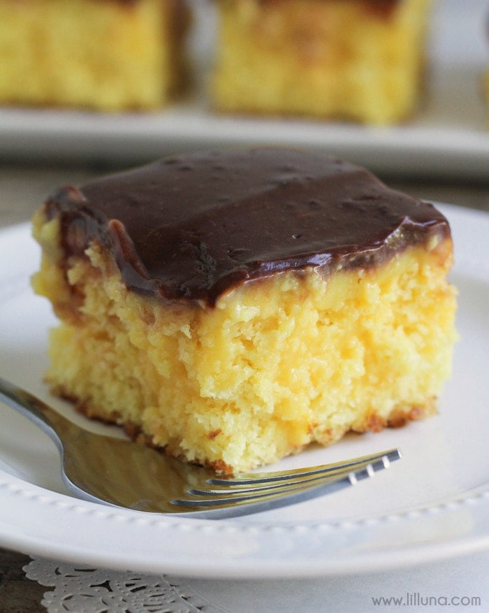 A cool and creamy recipe for Boston Cream Poke Cake. If you love the yellow cake and chocolate combo, you'll LOVE this dessert!! Recipe on { lilluna.com }