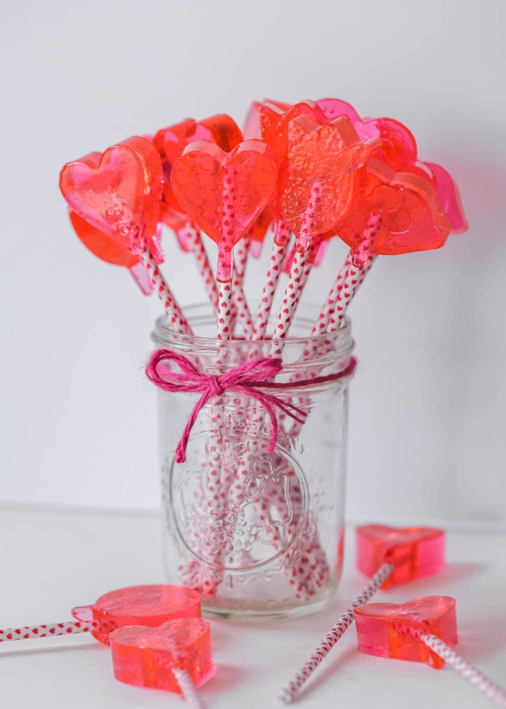 Pink homemade suckers in a mason jar