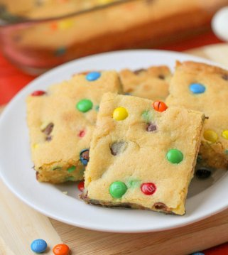 cake mix cookie bars with M&Ms on white plate