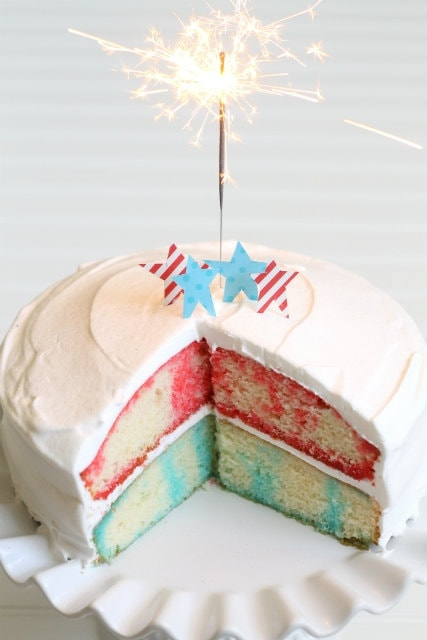 Patriotic Poke Cake - perfect for the Fourth of July!! Moist and refreshing with cool whip frosting!