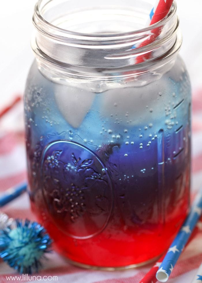 Red, white, and blue 4th of July drink in a mason jar