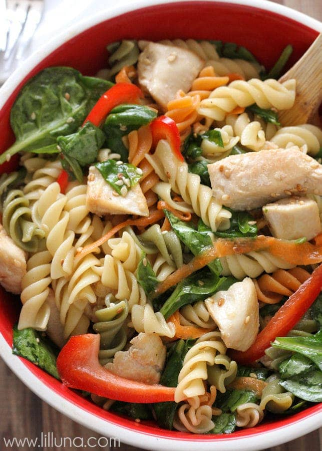 Delicious Asian Pasta Salad recipe - so delicious and flavorful! Pasta, chicken, carrots, spinach in a yummy dressing!!