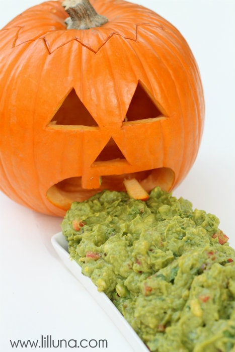 Barfing Pumpkin Guacamole - this is so easy to make and is perfect for you Halloween party!! If you love avocados, you'll love this recipe.