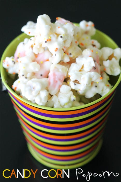 Candy Corn Popcorn Mix!! A delicious treat that all will love!! So easy to make! Popcorn and candy corns coated in white chocolate and sprinkles.
