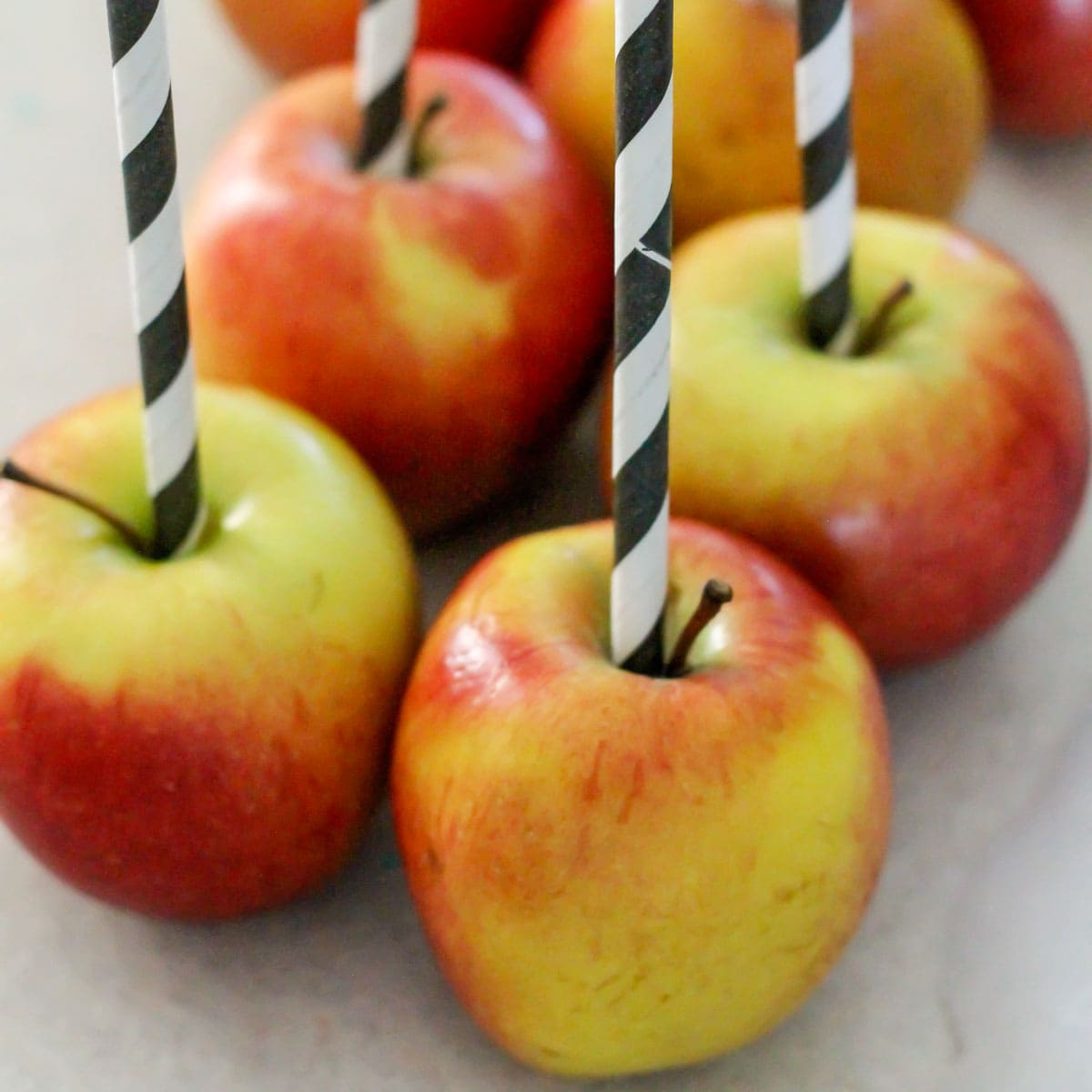 apples with straws stuck in the top