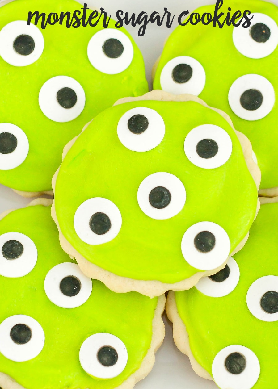 Monster Eye Sugar Cookies - perfect for Halloween or a Monster party! A soft sugar cookie frosted with a powdered sugar and almond extract frosting and topped with candy eyes!