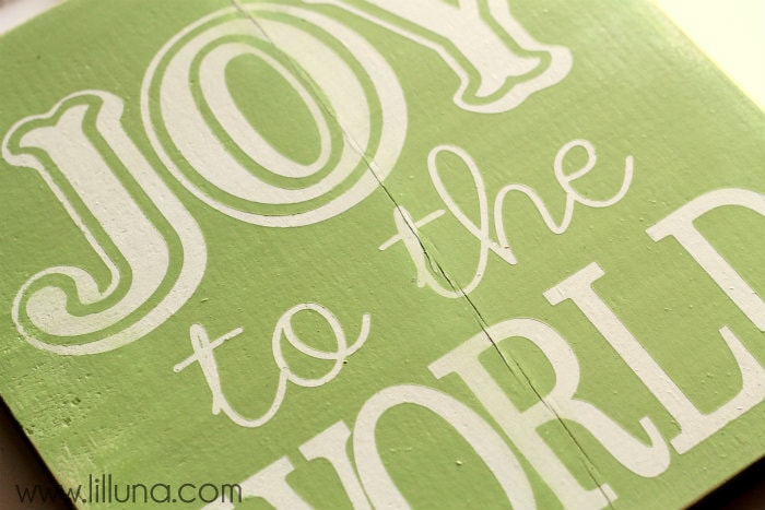 Joy to the World Sign Tutorial!! This is such a cute and easy sign to make! Supplies include wood, vinyl, paint, and fabric pieces!