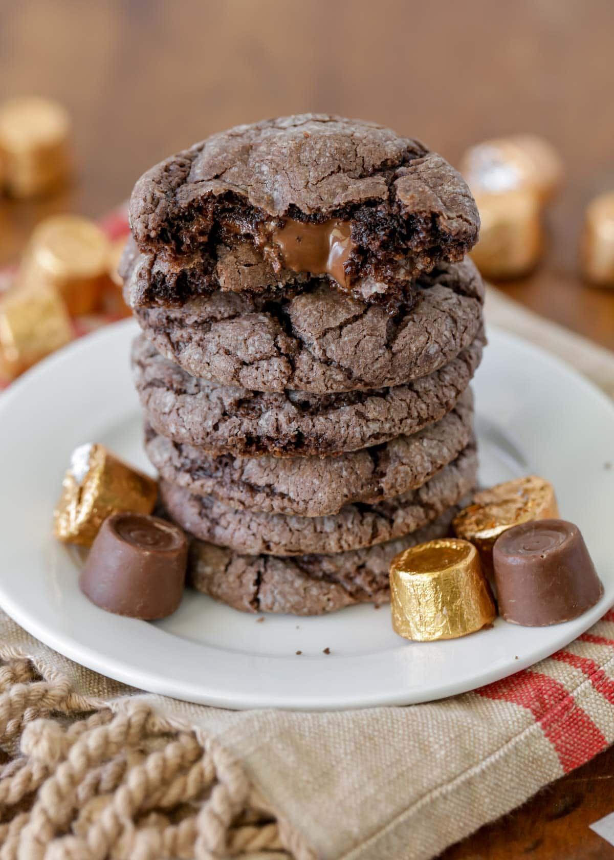 Stack of chocolate Rolo cookies on a white plate