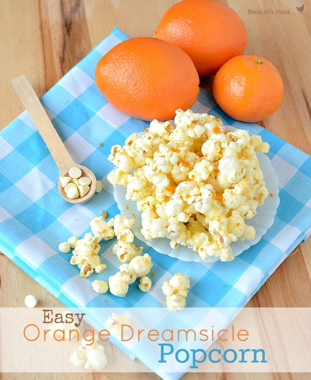 Easy Orange Dreamsicle Popcorn recipe on { lilluna.com }. Ingredients include popcorn, juice & zest from an orange, & white chocolate chips.