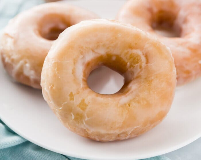 Closeup of donuts on a white plate