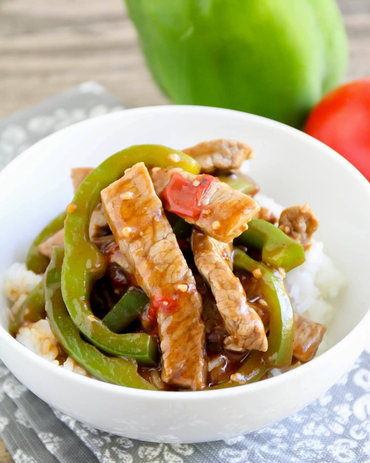 Chinese pepper steak with vegetables served over white rice