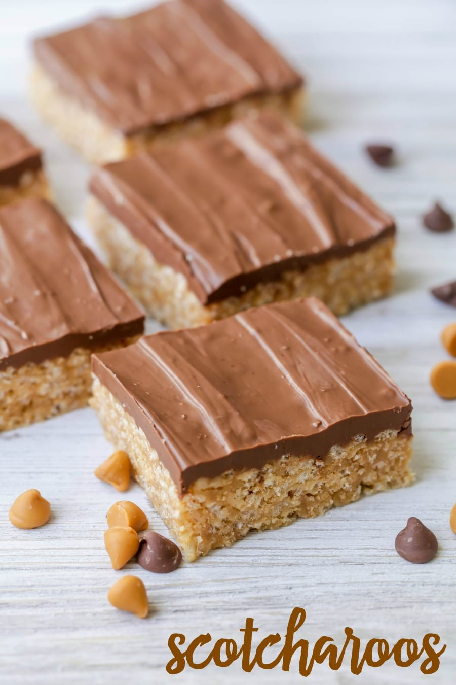 Delicious, irresistible Scotcharoos - a peanut butter crispy bottom topped with a butterscotch and chocolate topping!