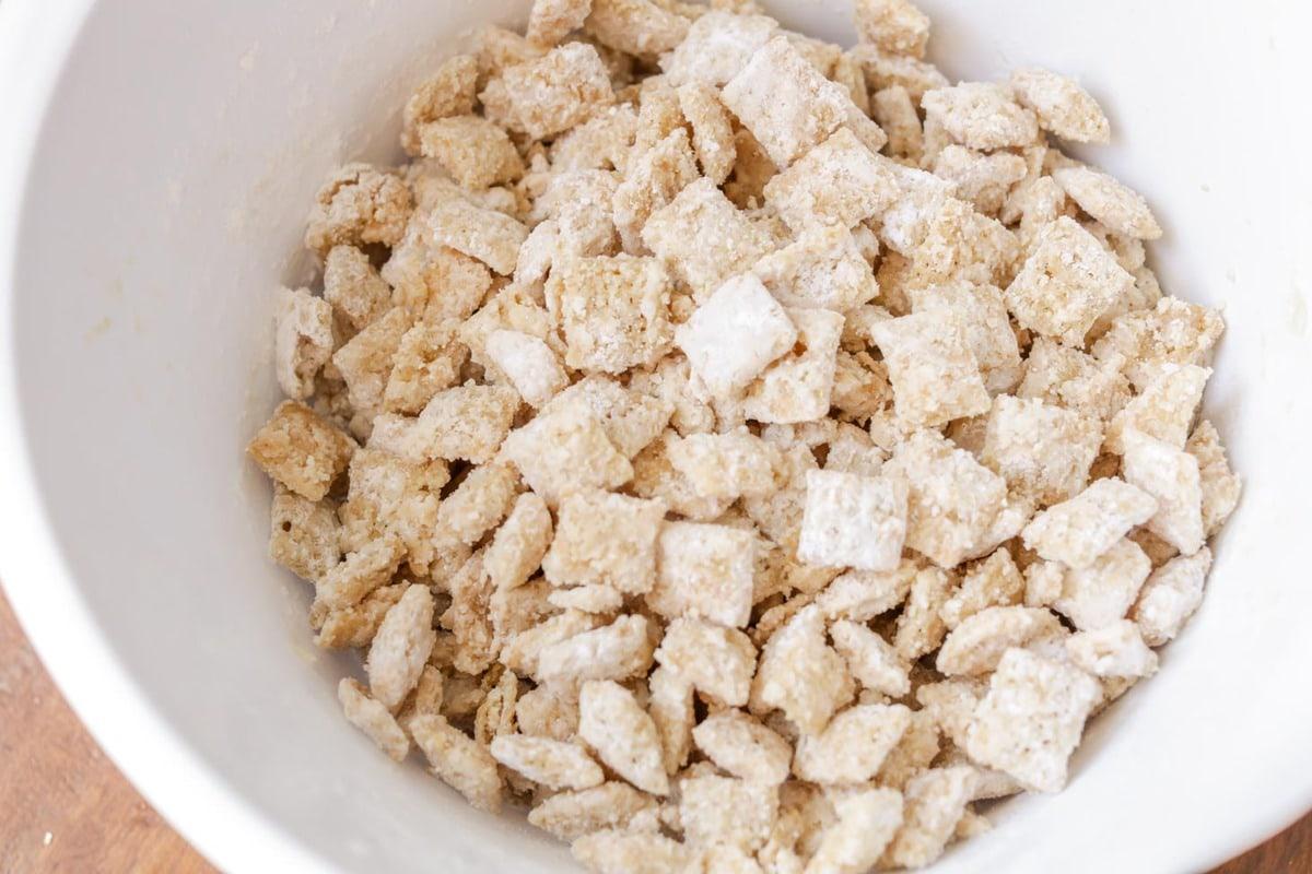 White chocolate muddy buddies recipe in a white bowl