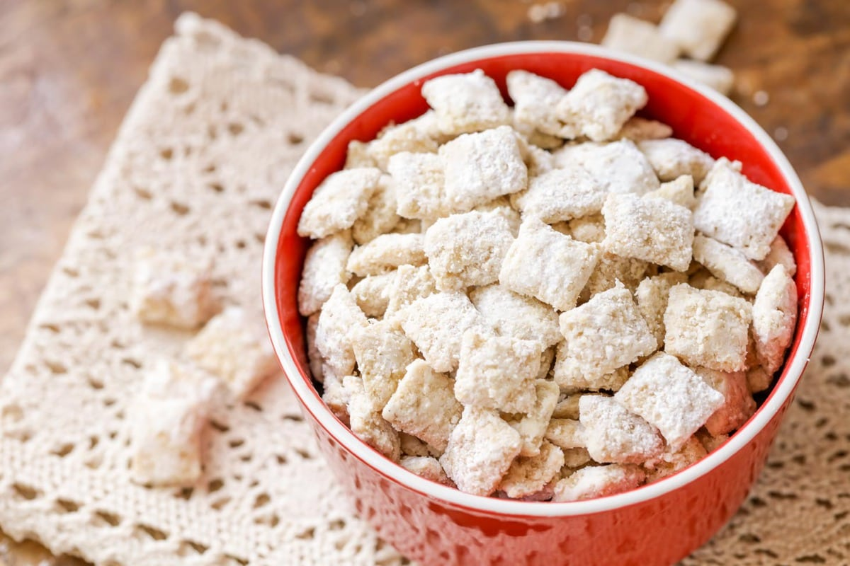 White chocolate puppy chow in red bowl