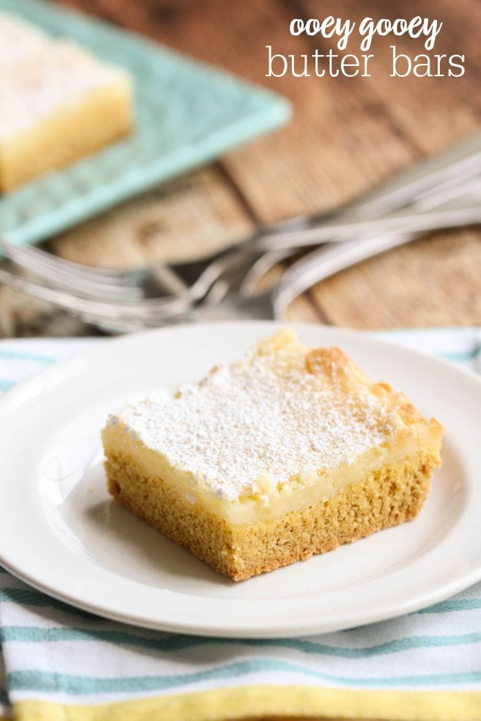 Ooey Gooey Butter Bars - yes, please!! An easy dessert that everyone loves { lilluna.com } So soft, they melt in your mouth - made with a yellow cake mix, powdered sugar, and cream cheese!
