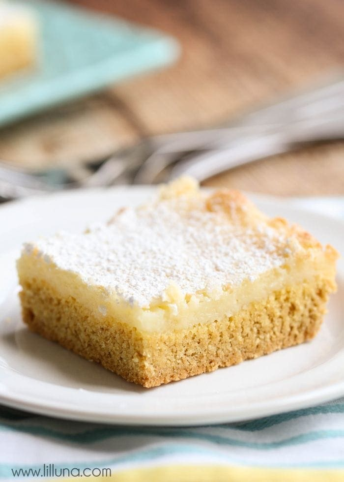 Ooey Gooey Butter Bars - yes, please!! An easy dessert that everyone loves { lilluna.com } Melts in your mouth - made with a yellow cake mix, powdered sugar, and cream cheese!