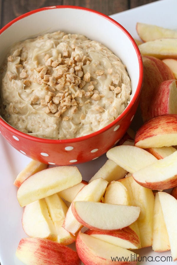 5-Ingredient Apple Brickle Dip recipe - takes minutes to make and is so delicious! Common ingredients including, cream cheese, brown sugar, sugar, & vanilla. An added flavor Heath Toffee Bits!
