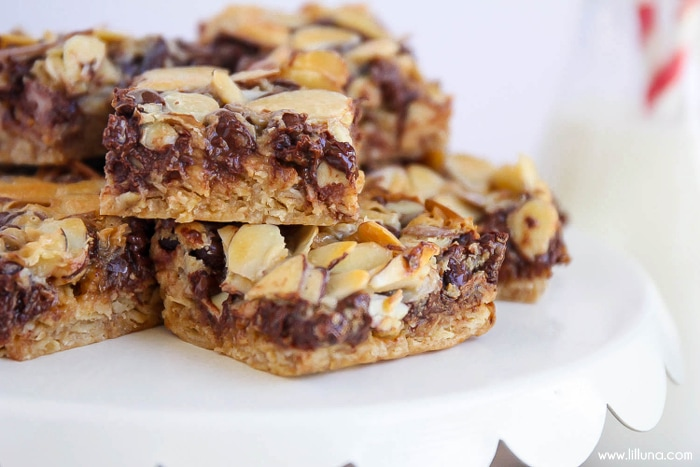 Almond Toffee Bars recipe - so delicious and easy to make! Ingredients include oats, sliced almonds, chocolate chips, & toffee bits.