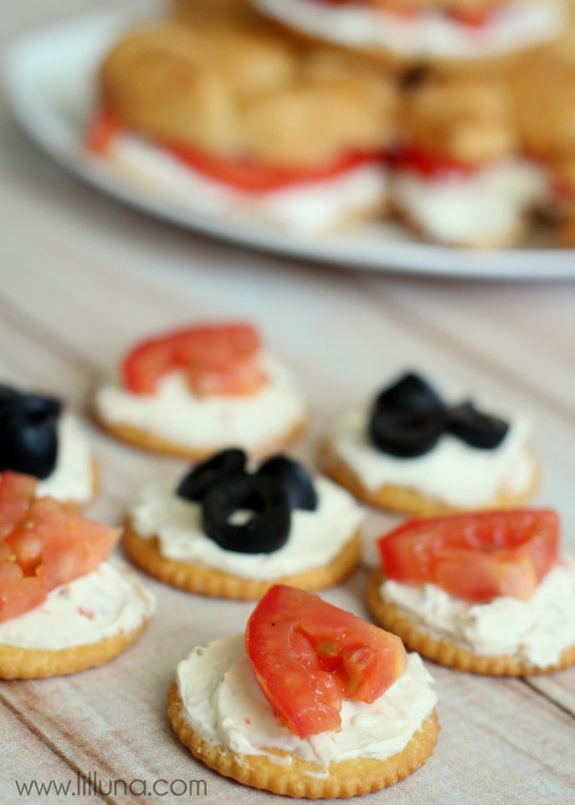 Cream Cheese Cracker Bites. Ritz crackers, cream cheese, olives & tomatoes!
