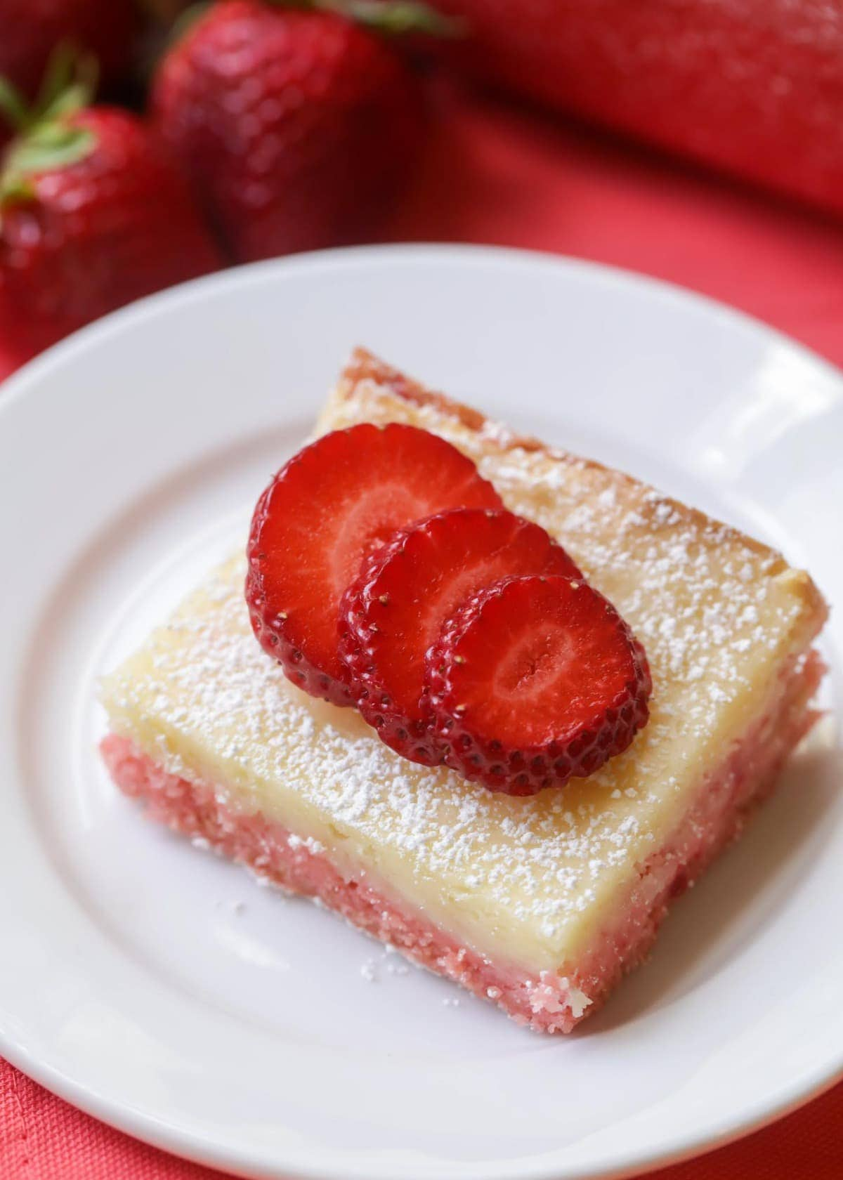 Gooey Butter Strawberry Bars - These are so delicious and soft! Made with a strawberry cake mix!