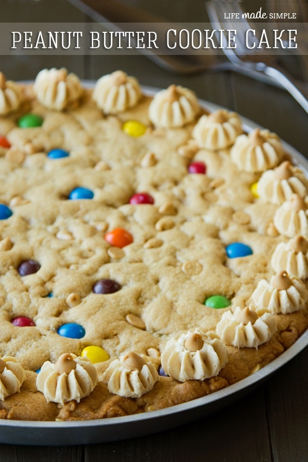 Peanut Butter Cookie Cake { lilluna.com } So delicious and if you love peanut butter, you'll love this cookie cake, also with m&m's!