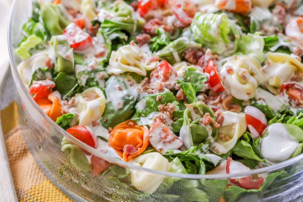 Easy tortellini salad with tomatoes, ranch, romaine and bacon bits