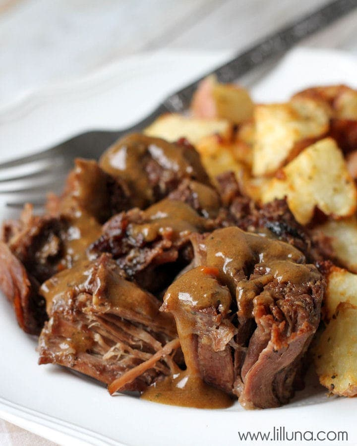 Our favorite Pot Roast recipe - 2 minute prep time and just stick in the crock pot! { lilluna.com } Roast is full of flavor from the brown gravy, Italian, and ranch dressing mix!!