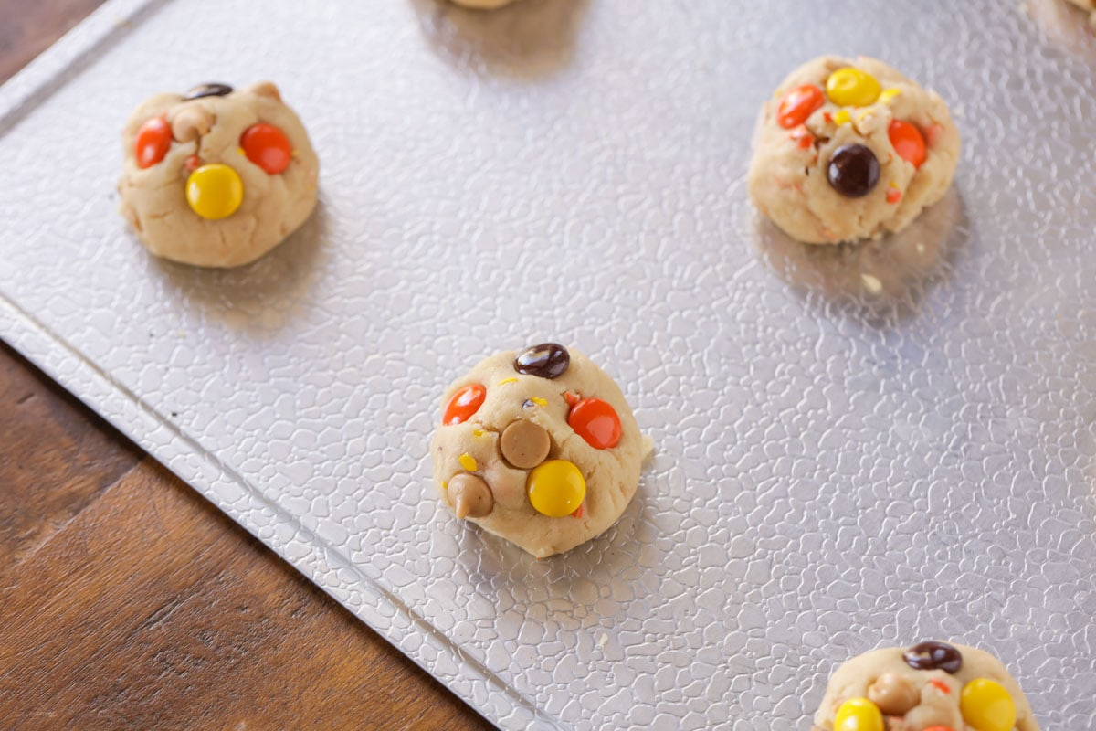 Reese's Pieces cookie dough on a baking sheet
