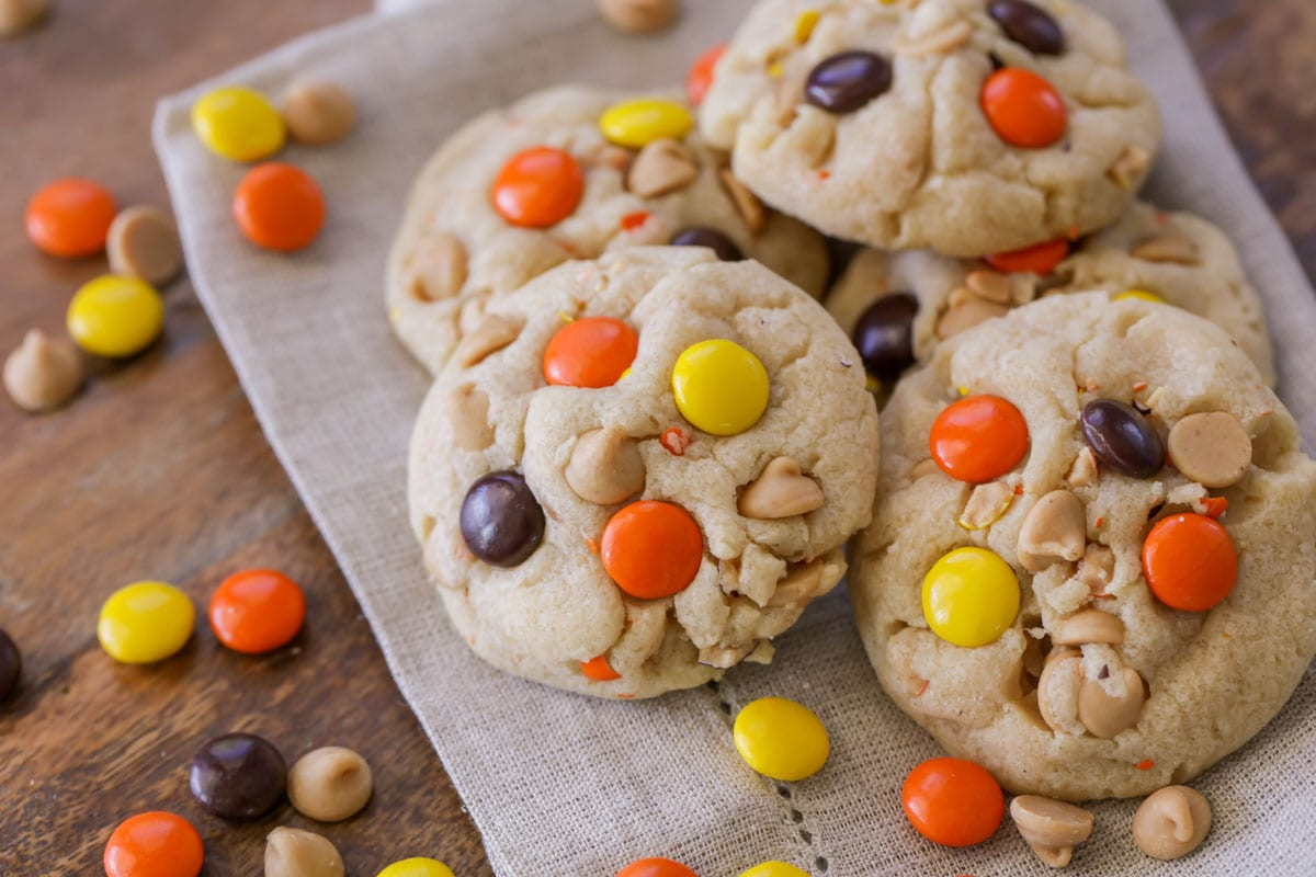A stack of Reese's Pieces Cookies with peanut butter chips and Reese's Pieces