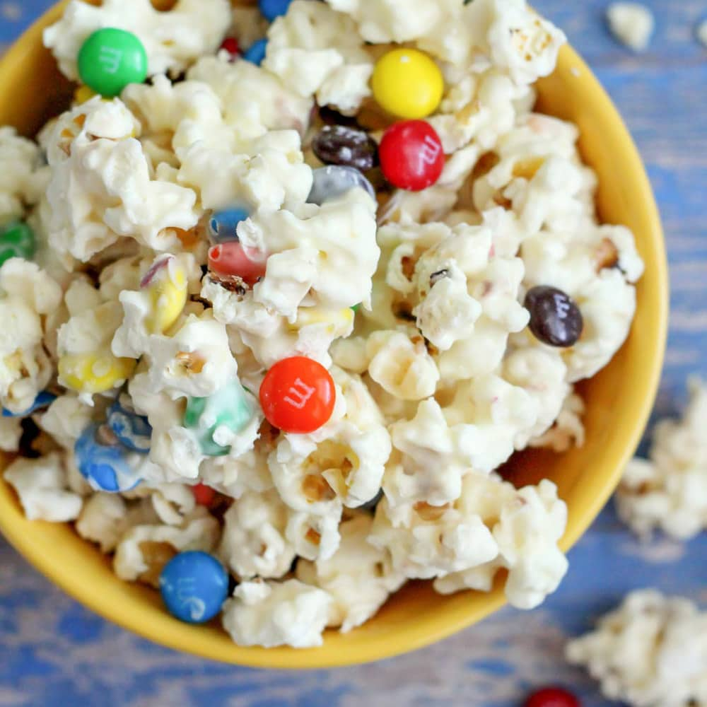 White chocolate popcorn with M&Ms in bowl
