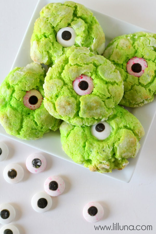Ooey Gooey Monster Eye Cookies Recipe - so good and perfect for Halloween! Yellow cake mix, cream cheese, & powdered sugar with green food coloring and a candy eye on top!