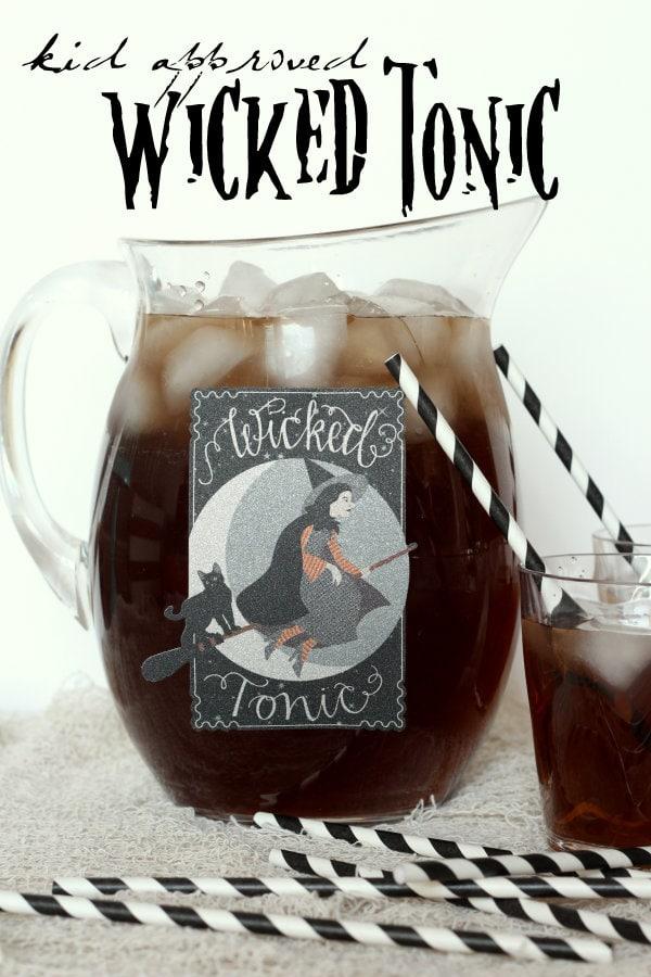Easy Ghoul-Aid recipe perfect for Halloween! { lilluna.com } Orange & grape kool-aid mixed with sugar, water, & sprite!!