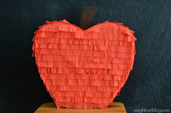 Teacher's Apple Piñata Tutorial on { lilluna.com } So cute and easy to make! Supplies include cardboard, red streamers, & brown paint!!