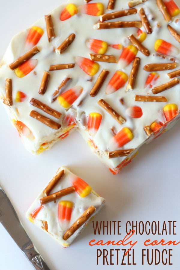 White Chocolate Candy Corn Pretzel Fudge! So delicious and easy to make!! Recipe includes marshmallow fluff, heavy cream, pretzels, candy corn, and white chocolate chips.