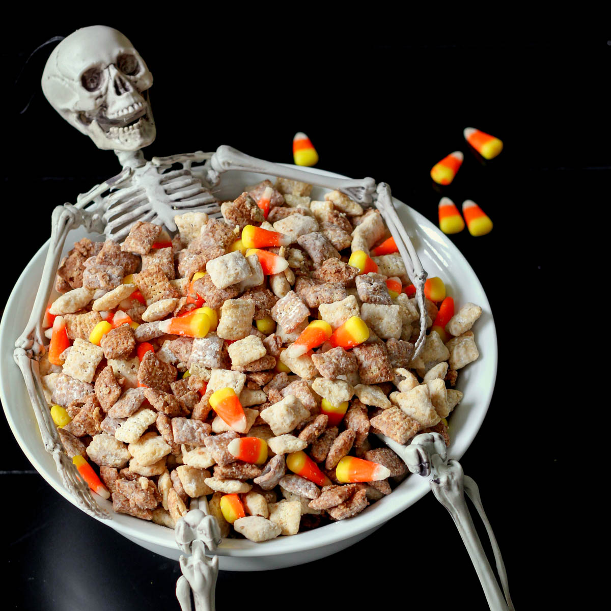 Halloween Puppy Chow in a skeleton bowl