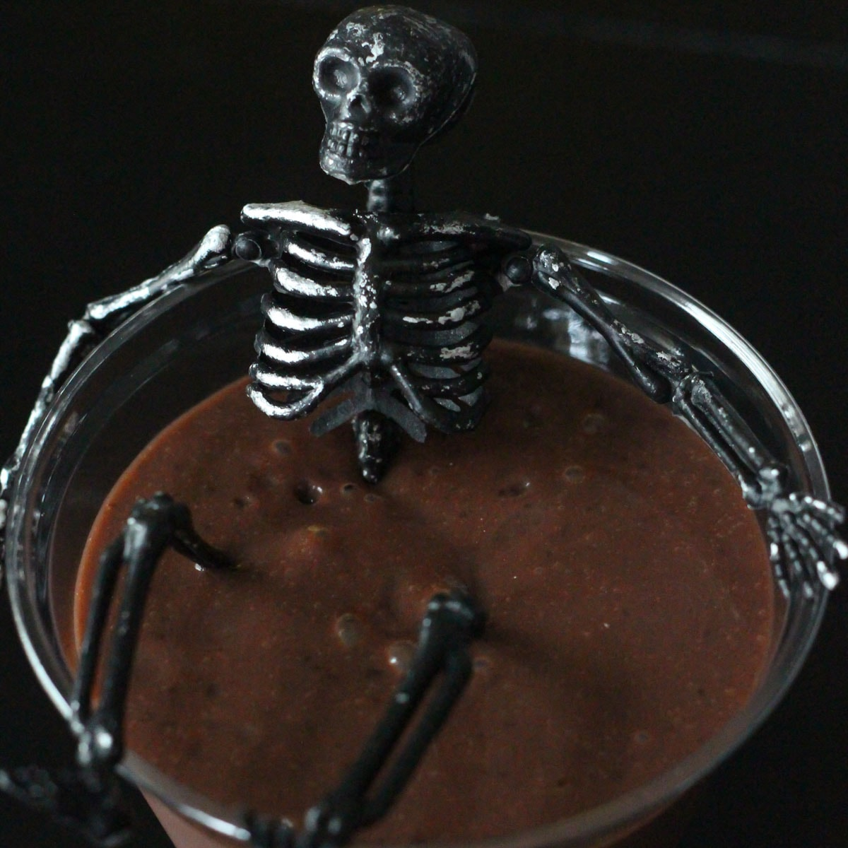 Black skeleton in chocolate pudding