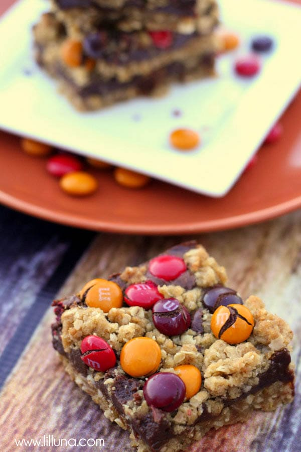 Delicious M&M Chocolate Oat Bars recipe. A yummy bar made with oats, sweetened condensed milk, chocolate chips, and brown sugar with fall m&m's.