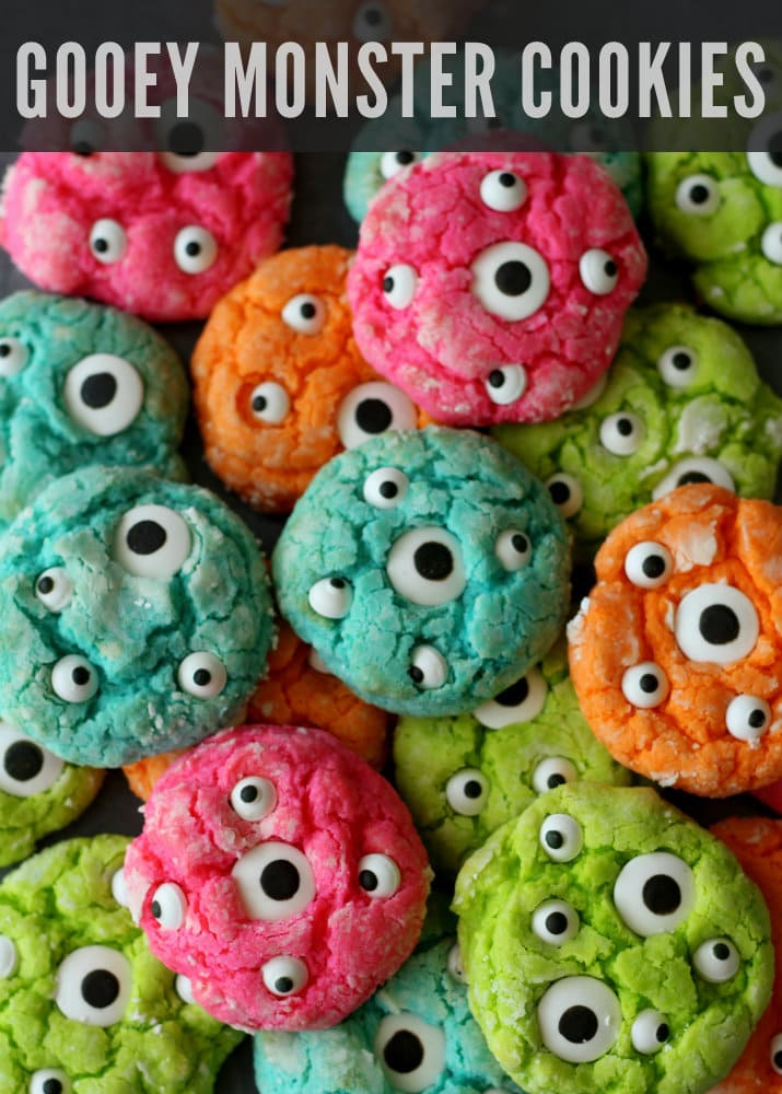 Gooey Monster Cookies Recipe on { lilluna.com } ADORABLE!! Bright & colorful. Ingredients include yellow cake mix, cream cheese, powdered sugar, food coloring, & candy eyes!
