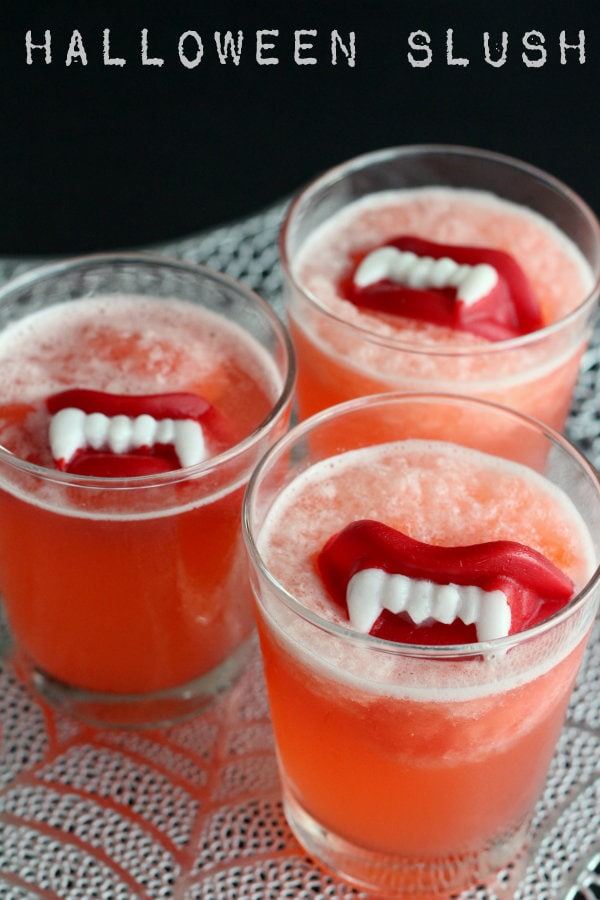 Halloween Slushy Punch Recipe with Wax Lips on { lilluna.com } #punch #slushy