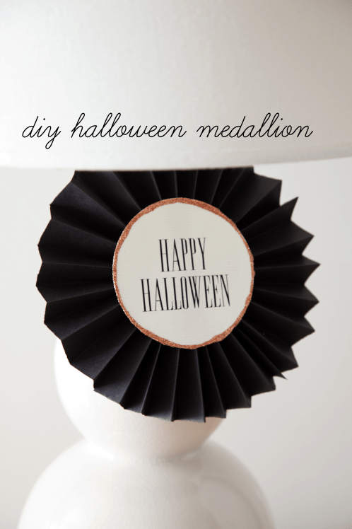 DIY Halloween Medallion Tutorial on { lilluna.com } Grab your paper, glue, & ribbon and you're set to make this cute medallion.