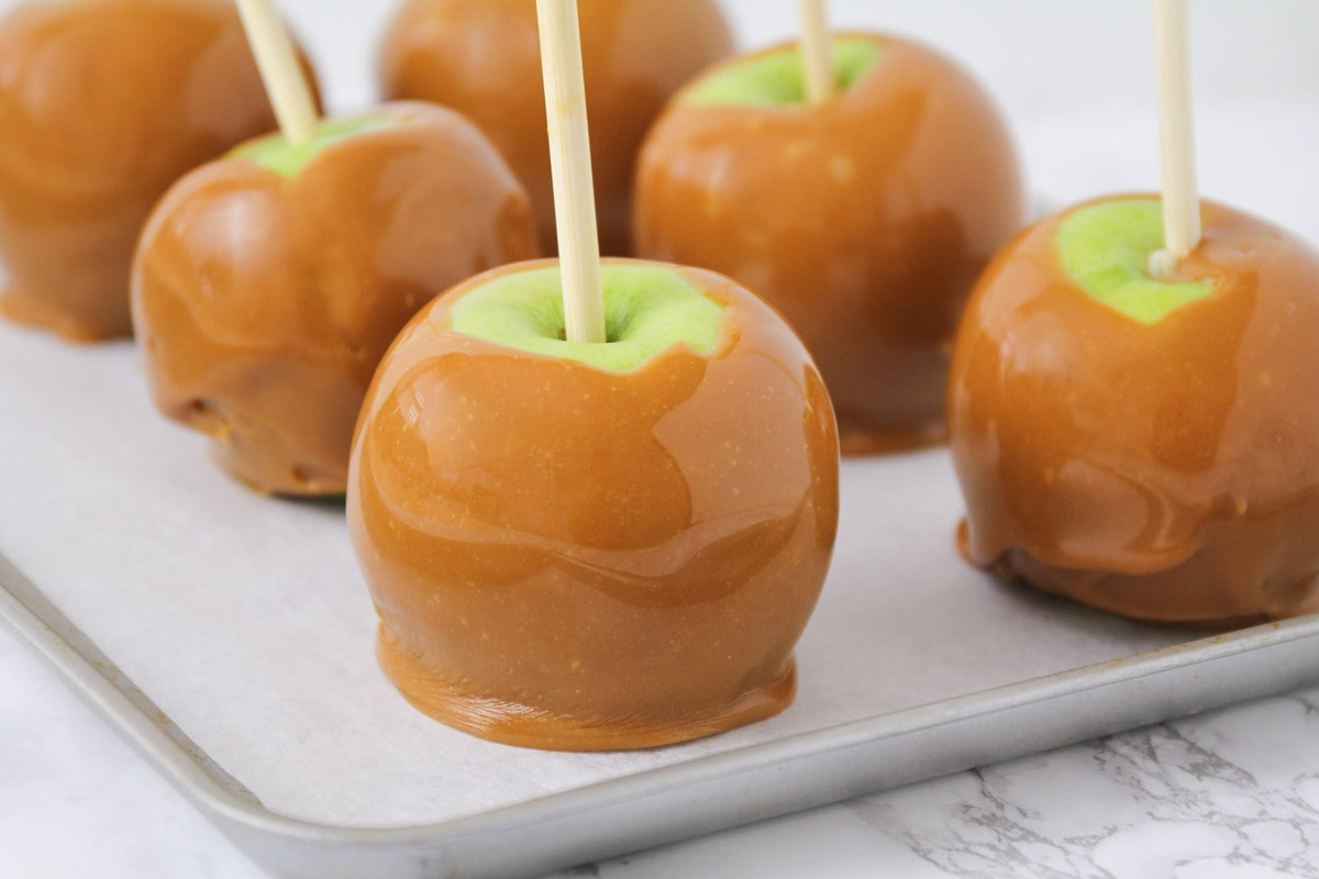 Caramel apples on cookie sheet
