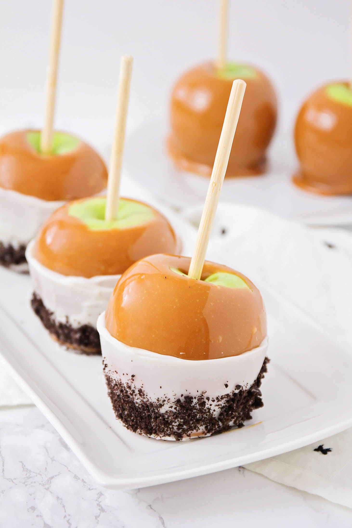 Gourmet Caramel apples on white tray