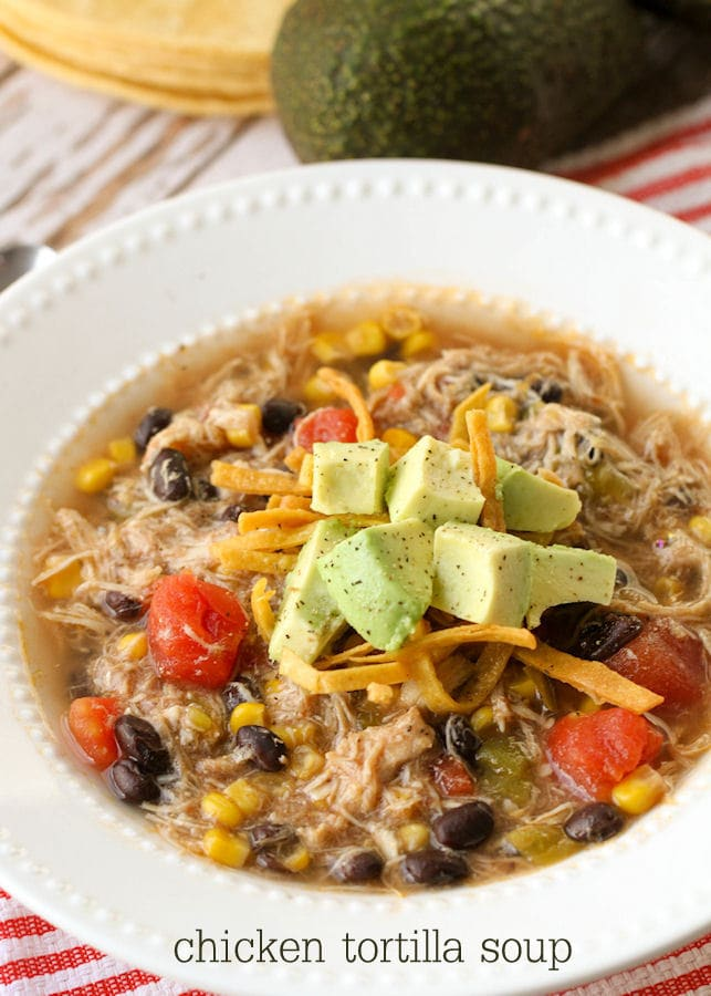 Chicken Tortilla Soup!! Delicious chicken, beans, tomatoes, corn, topped with tortilla strips and avocados!