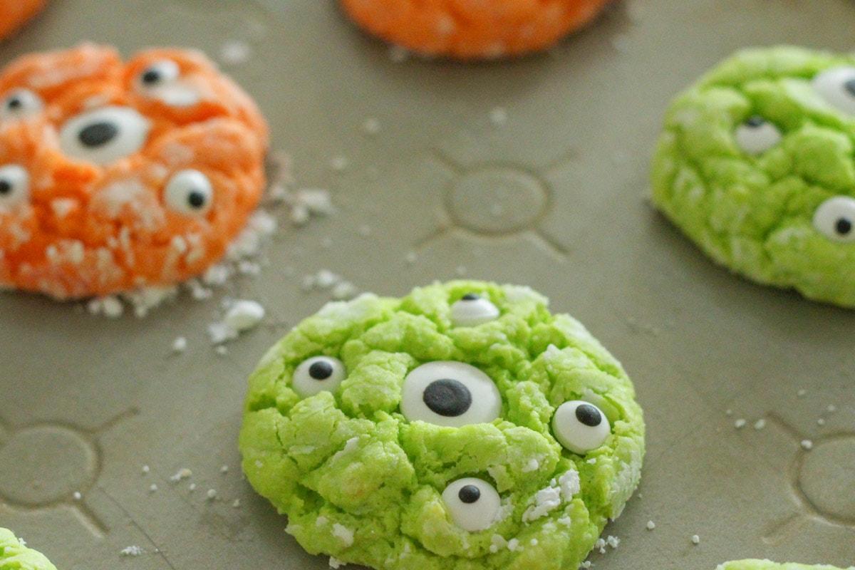 Gooey monster cookies on a sheet pan.