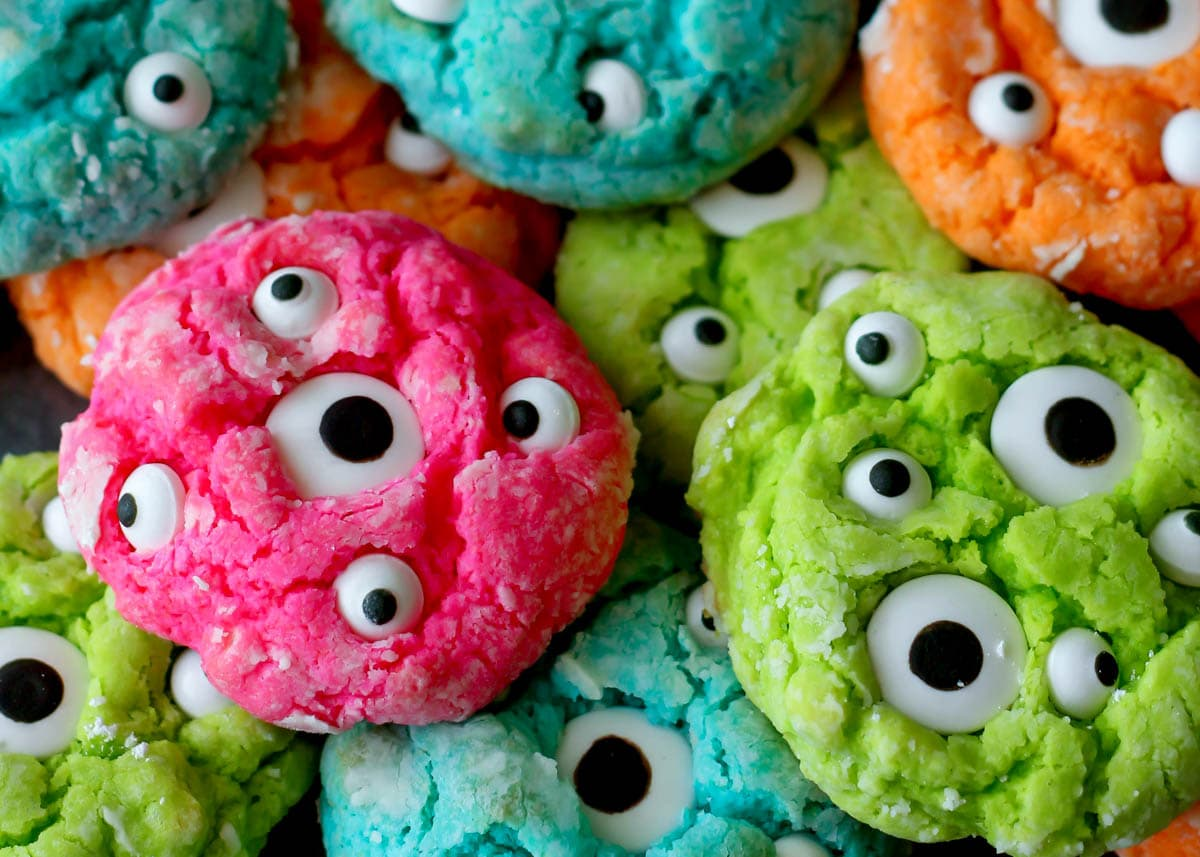 Gooey monster cookies in all shades stacked together.